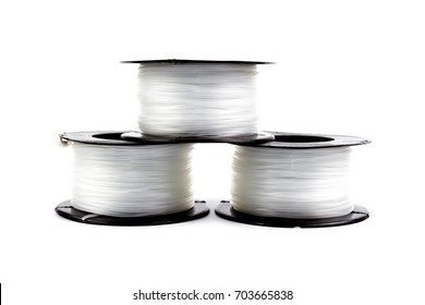 Three Clear Nylon line in roll for fishing or construction work isolated on white background