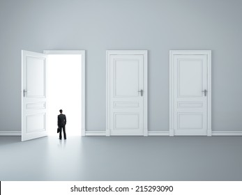 three closed doors and one opened by businessman