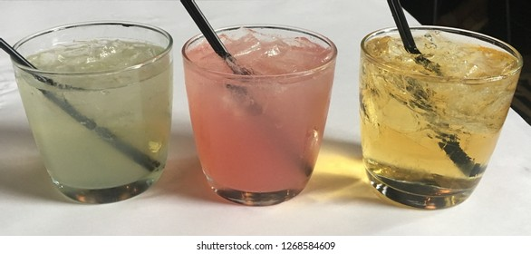 Three cocktails lined up in a row