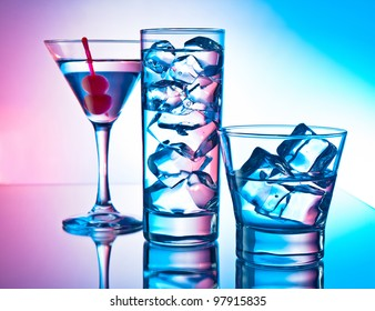 Three cocktails - martini glass, highball and old fashion