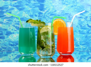 Three cocktails on blue background