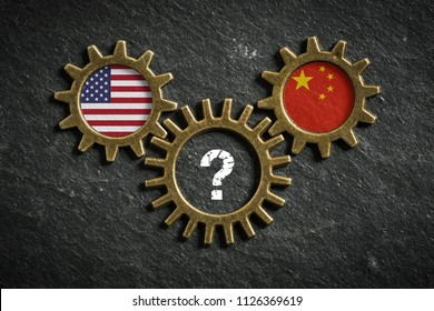 three cogwheels on slate background with the flags of USA and the China and a question-mark in the middle