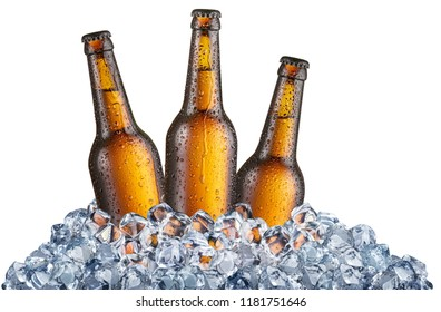 Three cold bottles of beer in the ice cubes. File contains clipping path.