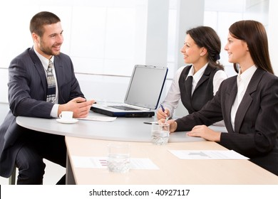 Three colleagues working  in the office