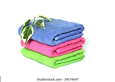 three color towels, pink, green and blue