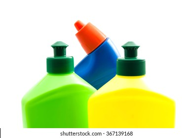 three colored bottles of detergent closeup on white