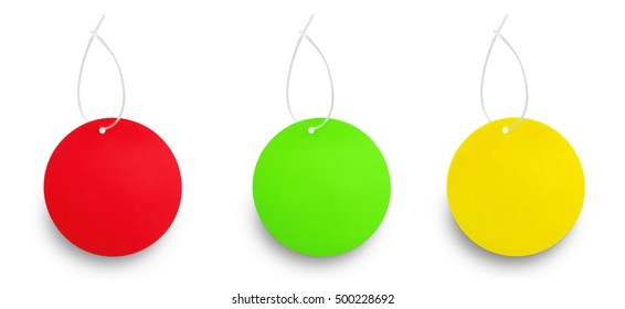 Three colored tags hanging isolated on white background. Traffic light concept. Red color,green color and yellow color.