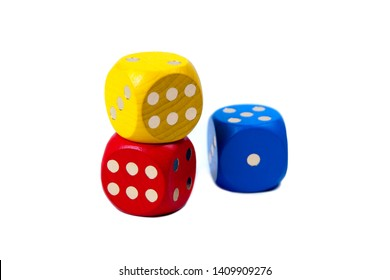 Three colorful game dices stacked, two of them showing six and one showing one isolated on white background. Six and one, contrast, more and less, luck in business concept