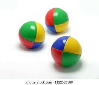 Three colorful juggling balls on white background