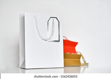 Three colorful paper shopping bag on white background
