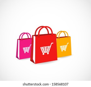 Three colorful paper shopping bags with basket icon