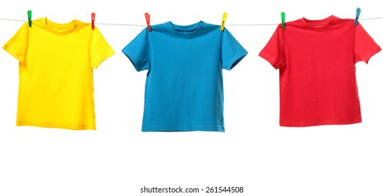 Three colorful shirts hanging on the clothesline. Image isolated on white background