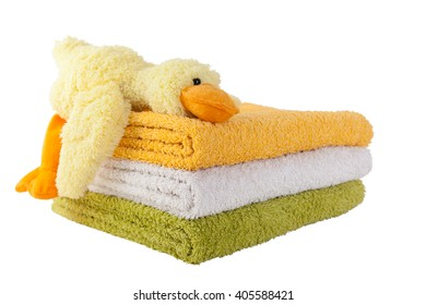 Three colorful towels with yellow plush duck isolated on white background