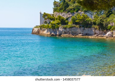 Three colour sea water and a castle on the seaside. A clean transparent water of Adriatic sea and Miramare castle on the seaside in Italy not far from Triest.