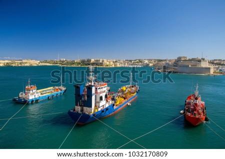 Three colourful cargo ships