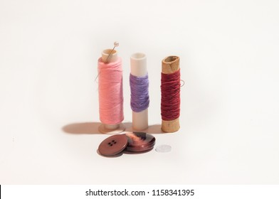 Three Colourful Coils of Thread and Thow Buttons