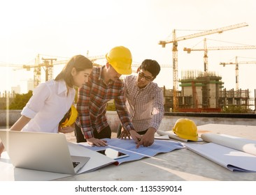 three construction engineers working together in construction site planning for the renovation