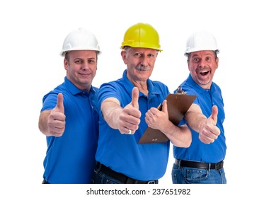 Three construction workers celebrating with a thumbs up