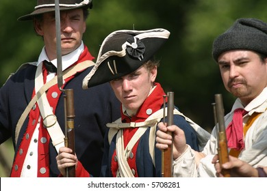 Three continental regular soldiers stand in formation before battle.