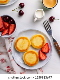 Three cottage cheese pancakes on a plate, overhead shot