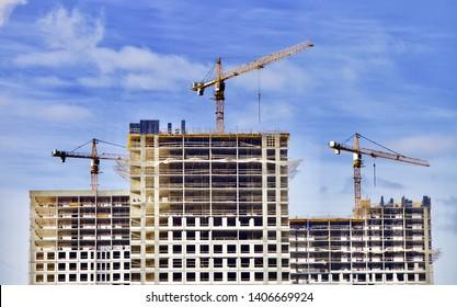 three crane building house. Construction industry. City development.