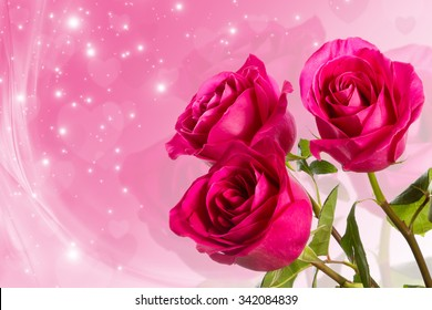 Three crimson roses on a festive background. Space for text.