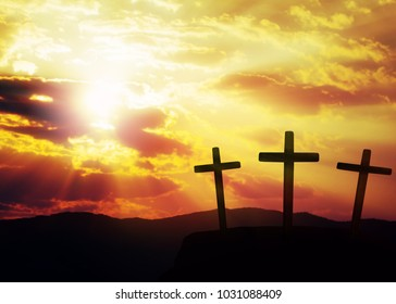 three cross on the hill in cloudy sunset. can be use for Easter or Christian background, copy space
