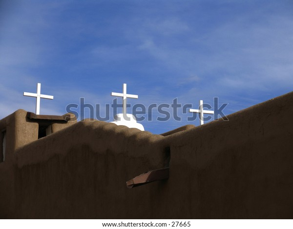Three crosses on a church building.