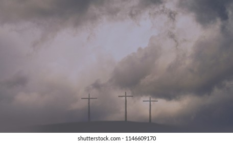 Three Crosses on a Hill in a Storm