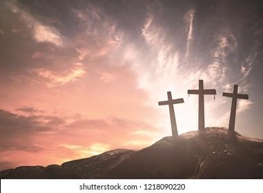 Three crosses on mountain sunrise background