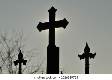 Three crosses silhouette, sky background in special lighting conditions, winter atmosphere