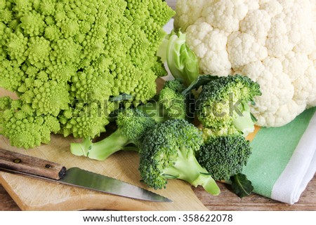 Three cruciferae  family vegetables: romanesque, broccoli and cauliflower