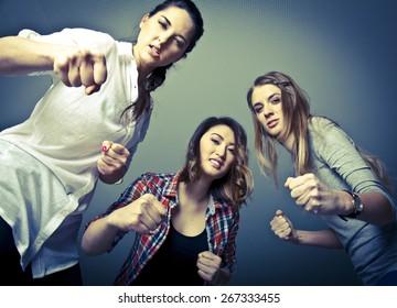 Three cruel girls beating their victim