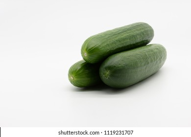 three cucumbers on a white background
