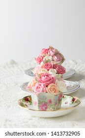 Three cupcakes  pink roses buttercream  for Birthday Newyear Valentine and festive with tea of cup and white background