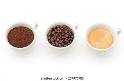 Three cups with coffee, beans and ground coffee