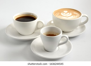 three cups with different types of coffee on a white background