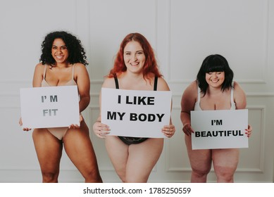 Three curvy girls posing in lingerie and having fun. Concept about body positivity