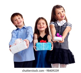 Three cute children give gifts. Isolated on white