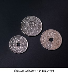 Three Danmark coins on the black background