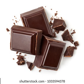 Three dark chocolate pieces isolated on white background. Top view