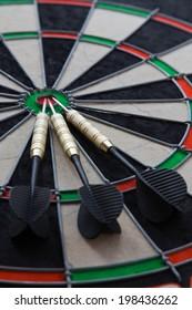 three darts on darts board