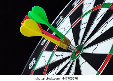 Three darts on target