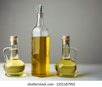 three decanter with olive oil isolated on gray or white background