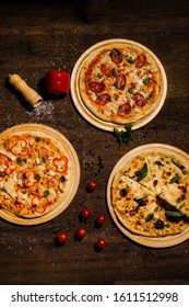 Three delicious italian pizza lies on the table