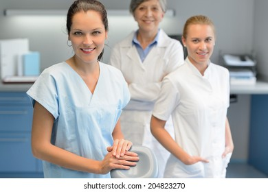 Three dentist woman team at dental surgery looking camera portrait