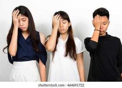 Three depressed Asian teenager girls