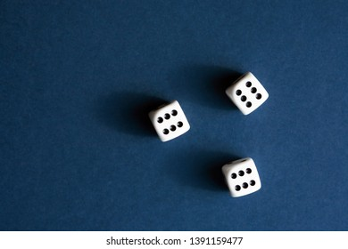 Three dice cubes on blue background with free space