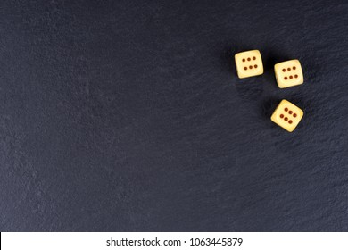 Three dices on black background. Six side dices with brown dots