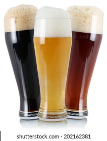 Three different beers in glass with foam, isolated on a white background